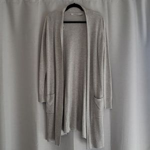 Long sleeve open front cardigan with pockets.